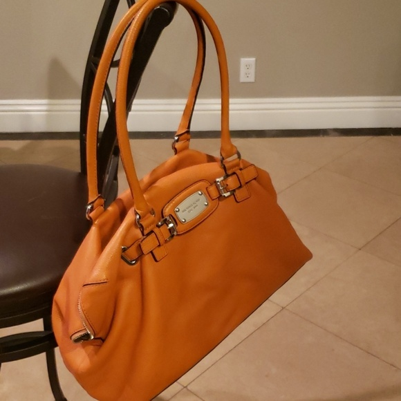 Michael Kors Handbags - Large orange Michael Kors shoulder bag.